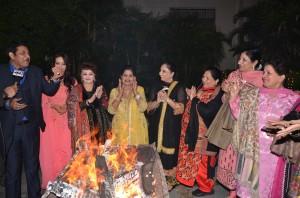 Women folks of WPO celebrating Lohri with famous Punjabi Singer Shankar Sahney.
