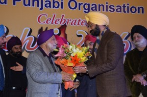 Sr. Parminder Dhindsa, Finance Minister of Punjab being greeted by Sr. Bhupinder Anand.