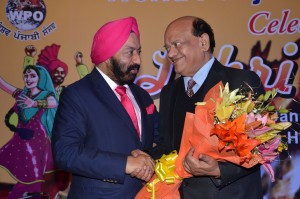 Sr. Vikram Sahney felicitating Sh. Surendera Sharma famous comedian.