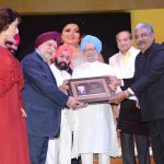 Sr. Bhupinder S Anand being honoured by Dr. Manmohan Singh