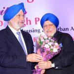 Sr. Bhupinder Anand felicitating Sr. Hardeep Puri ji