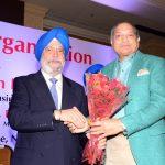 Sh. Ramesh Handa Felicitating Sr. Hardeep Puri ji.