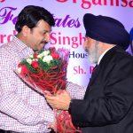 Sr. Amrit Thapar ji felicitating Sh. Manoj Tiwar ji