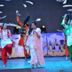 Satinder satti performing on her songs
