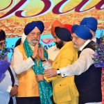 Sr. Hardeep Puri being felicitated by Sr. Vikramjit Singh Sahney and WPO Office bearers..